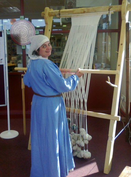 Operating a warp weighted loom copyright Shirley Walsh